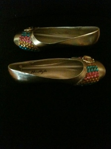Gold flats with pink, blue, and gold sparkles $20